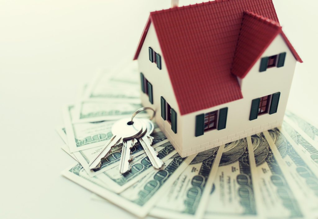 close up of home model, money and house keys